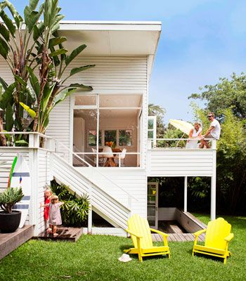 Yellow Outdoor Chairs add a sense of fun and whimsy to this outdoor space.